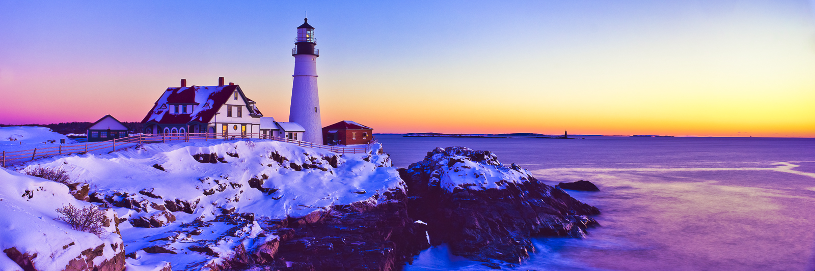 Day begins to break but offers no warmth to this frozen winter day on the Maine coast. Portland Head Light greats the sun with...
