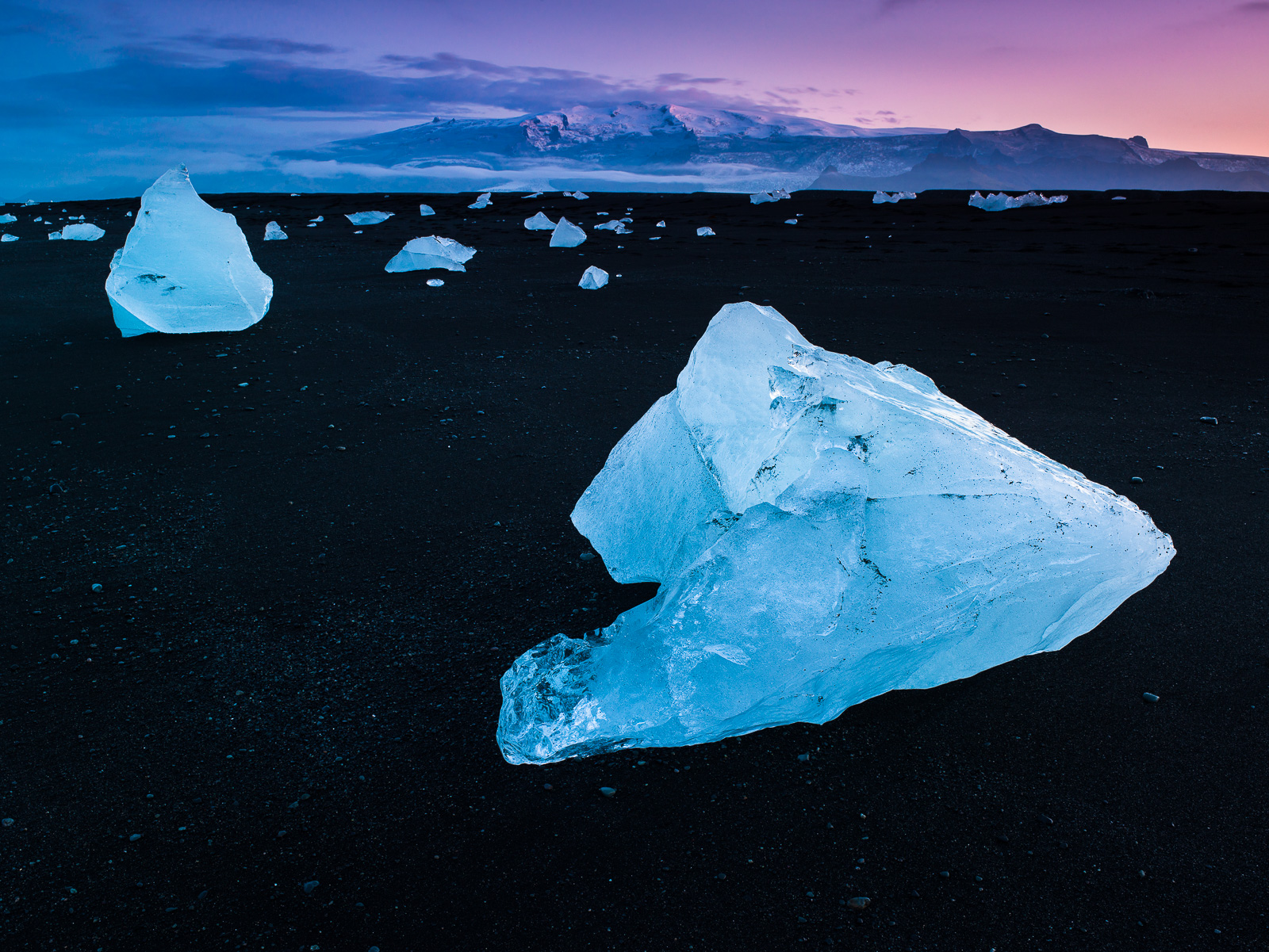Midnight light in Iceland is a dreamy thing indeed.   Huge ice chucks wash ashore from nearby glaciers.